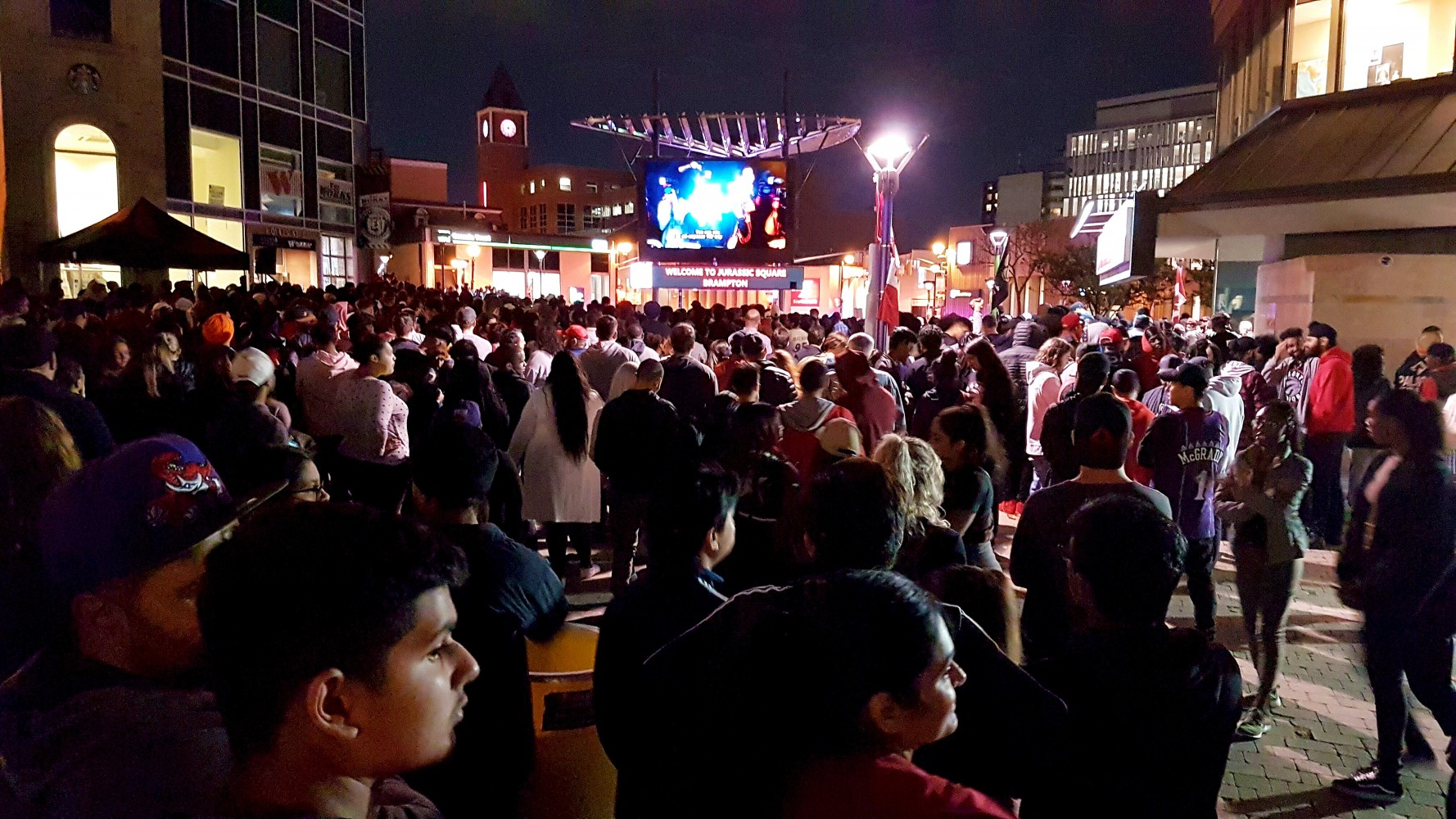 The gathering of people in a downtown square reminds us that we want to be together