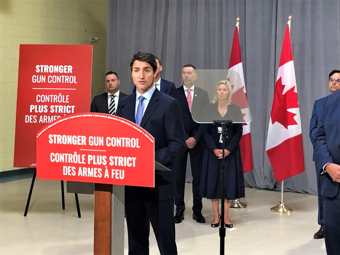 With Crombie sitting behind him Trudeau pledges $250-million to directly help cities combat gang-related violence